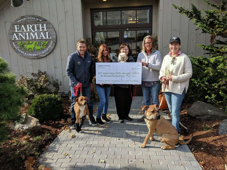 Earth Animal, 925 Post Road E., Westport, recently donated $2,500 to the Westport Animal Shelter Advocates. Earth Animal received the donations for its Love Brick Walkway in celebration of its new location in Westport. Pictured are Chris Wakeman and KJ Nicols, of Earth Animal store; Susan Pike, WASA; Nick Alexis, Earth Animal store; and Julie Loparo, WASA. Photo: Contributed Photo.