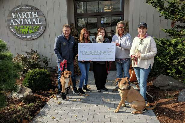 Earth Animal, 925 Post Road E., Westport, recently donated $2,500 to the Westport Animal Shelter Advocates. Earth Animal received the donations for its Love Brick Walkway in celebration of its new location in Westport. Pictured are Chris Wakeman and KJ Nicols, of Earth Animal store; Susan Pike, WASA; Nick Alexis, Earth Animal store; and Julie Loparo, WASA.