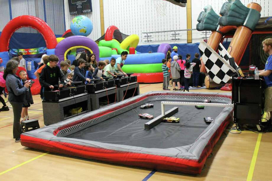 Over 400 people attended Ridgefield Parks and Recreation's Family Fun Day on Tuesday, November 5 at the Recreation Center. Activities included laser tag, plastic axe throwing, remote control car racing (above), and a photo booth. Photo: Contributed Photo