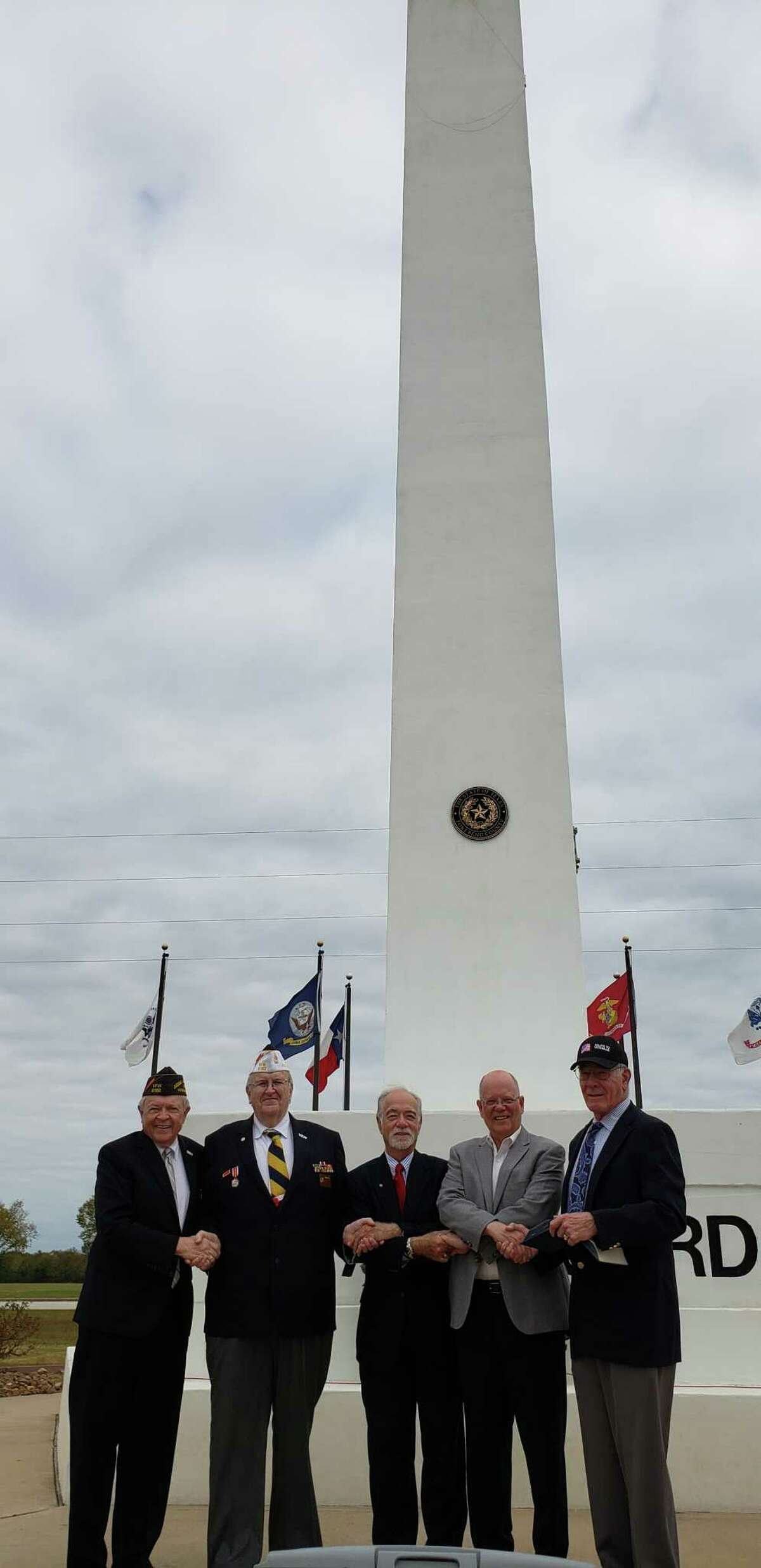 The Rotary Club of Katy and Katy Veterans of Foreign Wars Post 9182 observed Veterans Day on Nov. 11 at Armed Forces Memorial Tower in Fort Bend County Freedom Park. From left are: Ken Burton, Katy Rotarian; Don Byrne, VFW Post commander;  David Frishman, Katy Rotarian; Andy Meyers, Fort Bend County Precinct 3 commissioner; and Ron Hudson, colonel retired USACE.