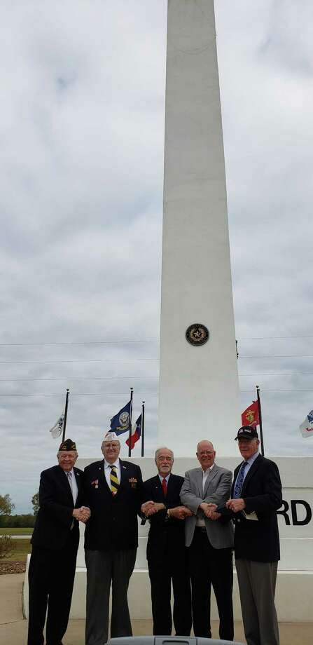 The Rotary Club of Katy and Katy Veterans of Foreign Wars Post 9182 observed Veterans Day on Nov. 11 atArmed Forces Memorial Tower in Fort Bend County Freedom Park. From left are:Ken Burton, Katy Rotarian; Don Byrne, VFW Post commander; David Frishman, Katy Rotarian; Andy Meyers, Fort Bend County Precinct 3 commissioner; and Ron Hudson, colonel retired USACE. Photo: Courtesy Rotary Club Of Katy