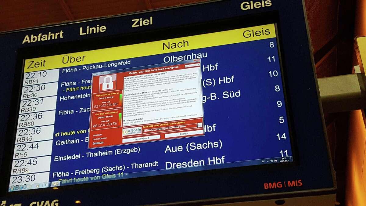 A display panel with an error can be seen at the main railway station in Chemnitz, Germany. Germany's national railway says that it was among the organizations affected by the global cyberattack but there was no impact on train services. Deutsche Bahn said early Saturday that departure and arrival display screens at its stations were hit Friday night by the attack. (P. Goezelt/dpa via AP)