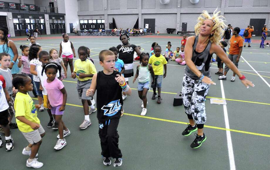 "A ""Zumba"" class for kids at the the annual ""Back to School Rally"" held at Hillhouse High. Photo: Peter Casolino / Hearst"