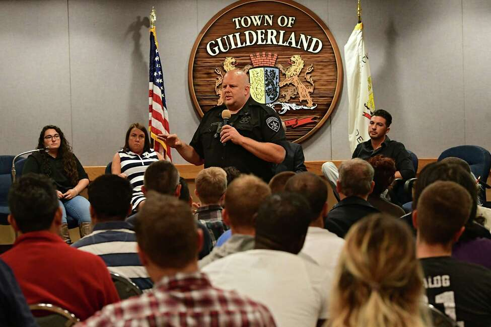 Brian Wood, commander of emergency planning unit, center, speaks during a Stop DWI program Victim Impact Panel at Guilderland Town Hall on Tuesday, Sept. 24, 2019 in Guilderland, N.Y. The program was offered in hope of showing them the possible consequences of their actions. Behind him are panelists. (Lori Van Buren/Times Union)