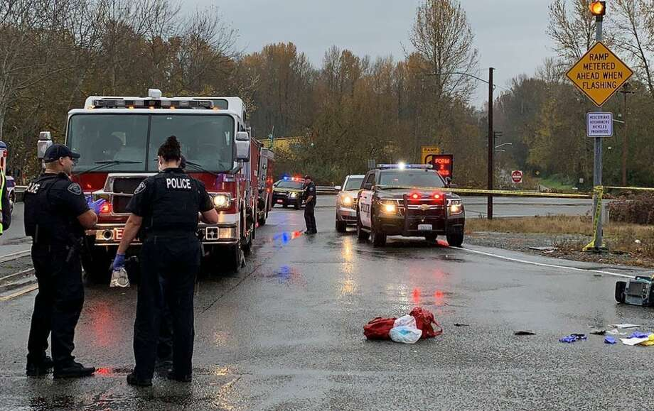 Police and medics respond to the scene where a naked man was shot by Renton police. (Photo: Renton Police Dept.) Photo: Photo: Renton Police Dept.