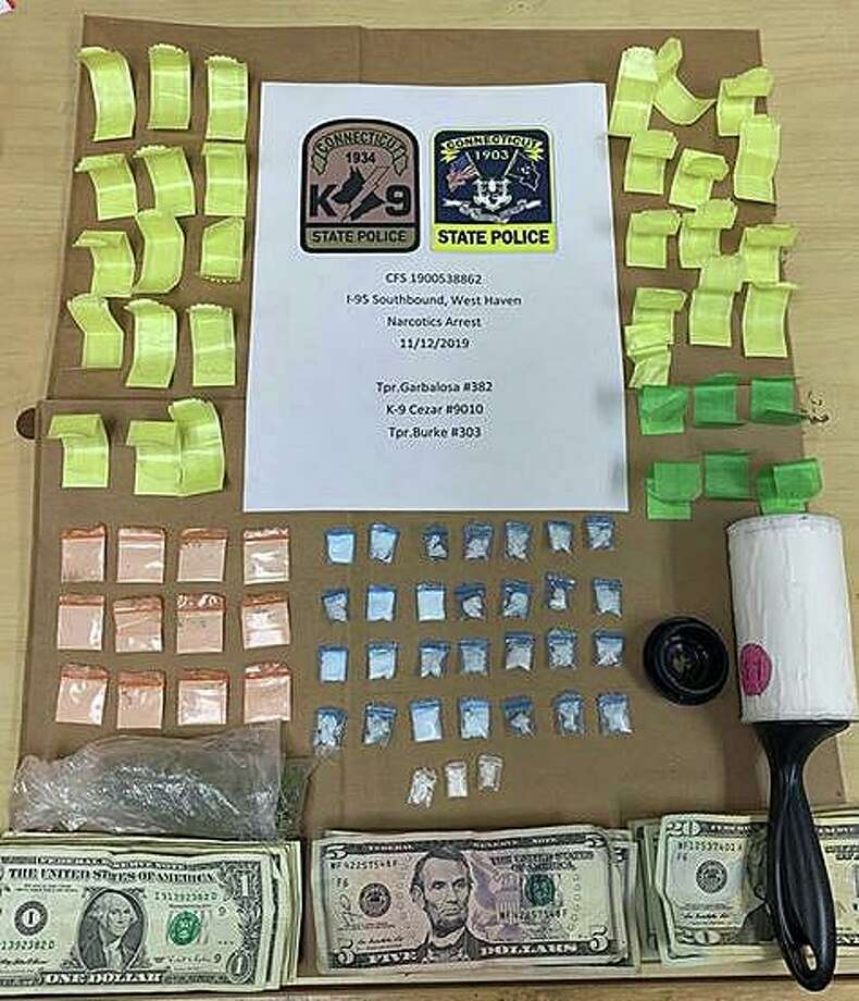 After stopping a driver on I-95 on Tuesday, Nov. 12, 2019 troopers found hidden inside a lint roller, 46 bags of suspected heroin, 31 bags of suspected crack cocaine and one bag of suspected marijuana. Photo: State Police Photo