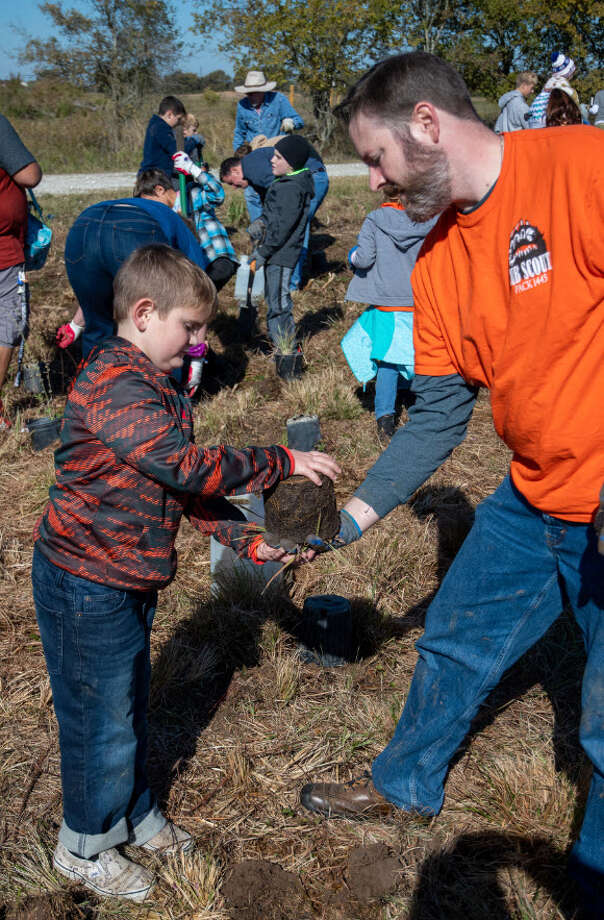 "Some 150 volunteers of all ages came out to the Katy Prairie Conservancy's Indiangrass Preserve to transplant native prairie plants to help restore the coastal prairie west of Houston during ""Putting Down Roots."" Photo: T. Kibodeaux"