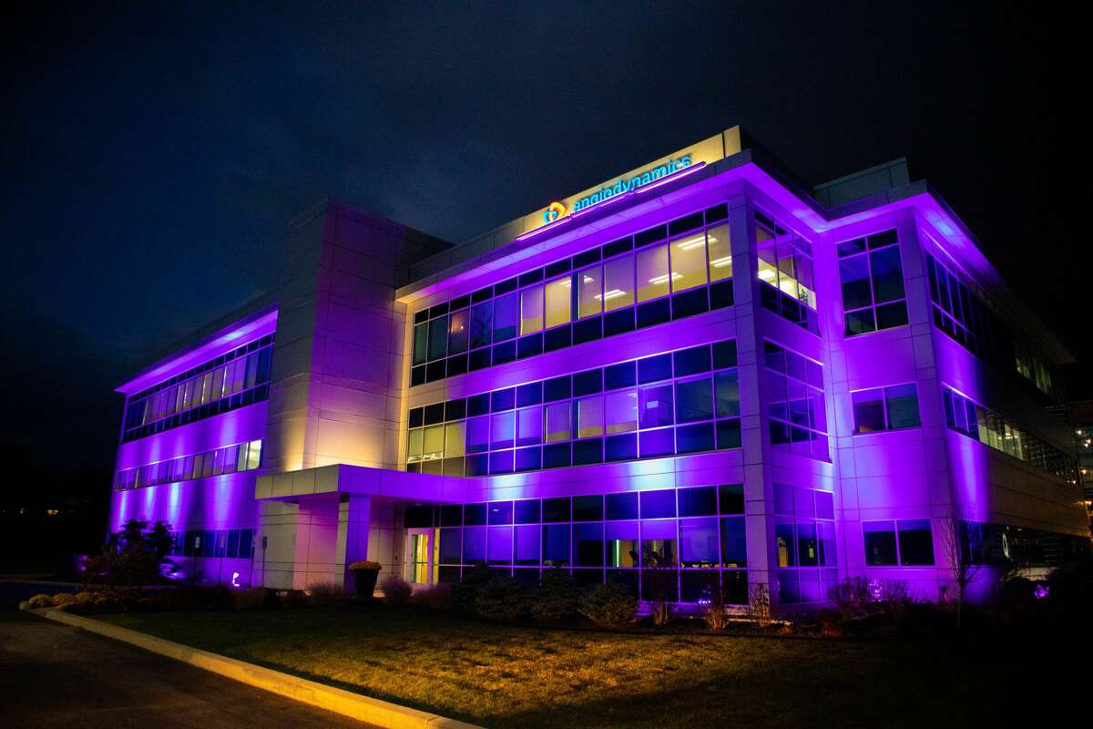 Angio Dynamics of Latham is lit purple earlier in November to serve as a beacon of hope for those with pancreatic cancer along the Northway
