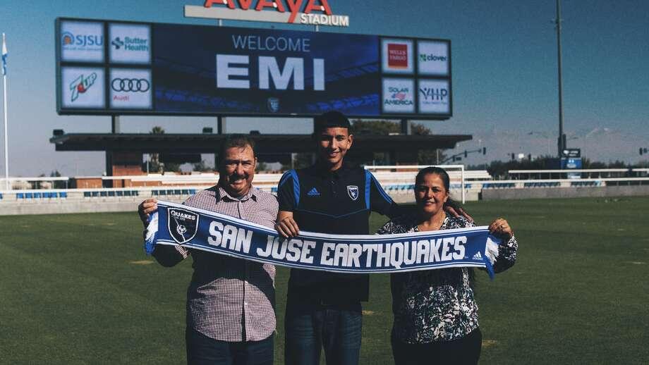 Emmanuel Oacha hold a San Jose Earthquakes scarf with his parents at Avaya Stadium. The San Jose Earthquakes signed Emmanuel Ocha, 14, to a Homegrown Player professional contract. Photo: San Jose Earthquakes