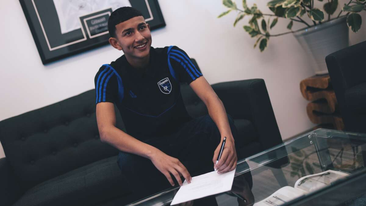 Emmanuel Ocha, 14, signs his Homegrown player pro contract with the San Jose Earthquakes.