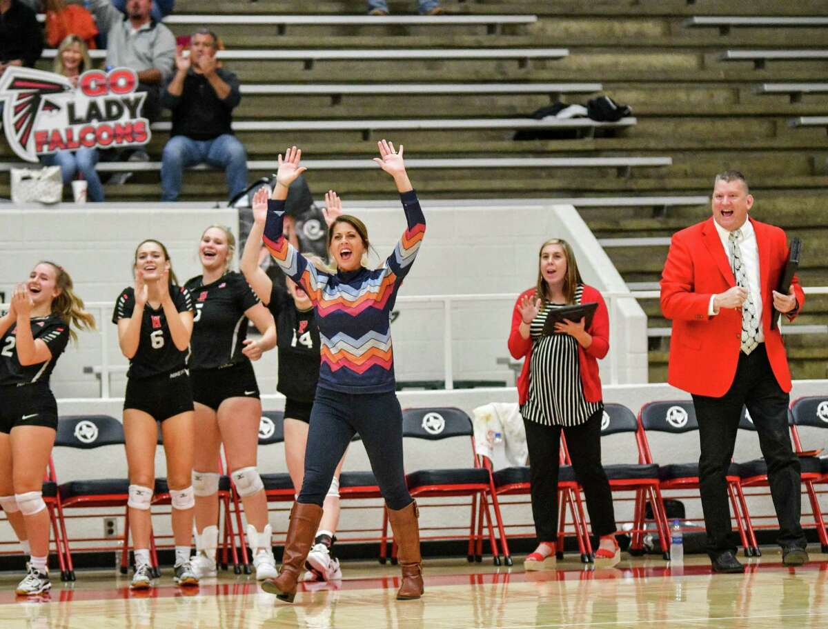 The Hargrave Volleyball coaches (left to right: Tammy White, Rachel Brownlow, Michael Williams) cheer on the team during its Area round playoff matchup against Columbia on Nov. 8 at Lee College in Baytown