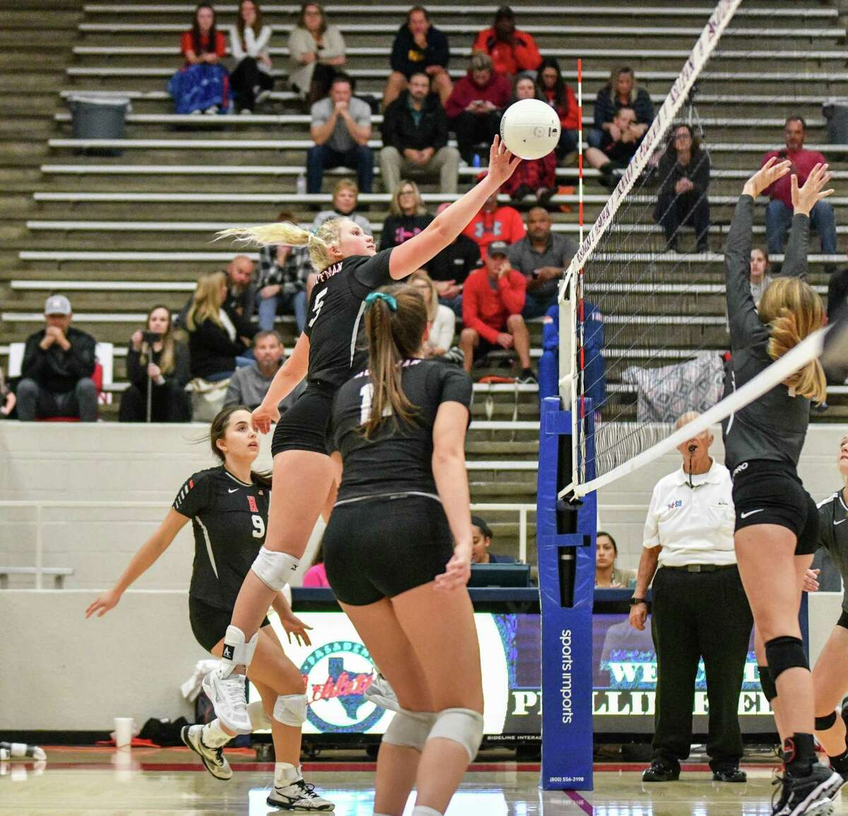 Hargrave's Breanna Jones (5) goes for a kill during an Area round playoff matchup against Columbia on Nov. 8 at Phillips Fieldhouse in Pasadena