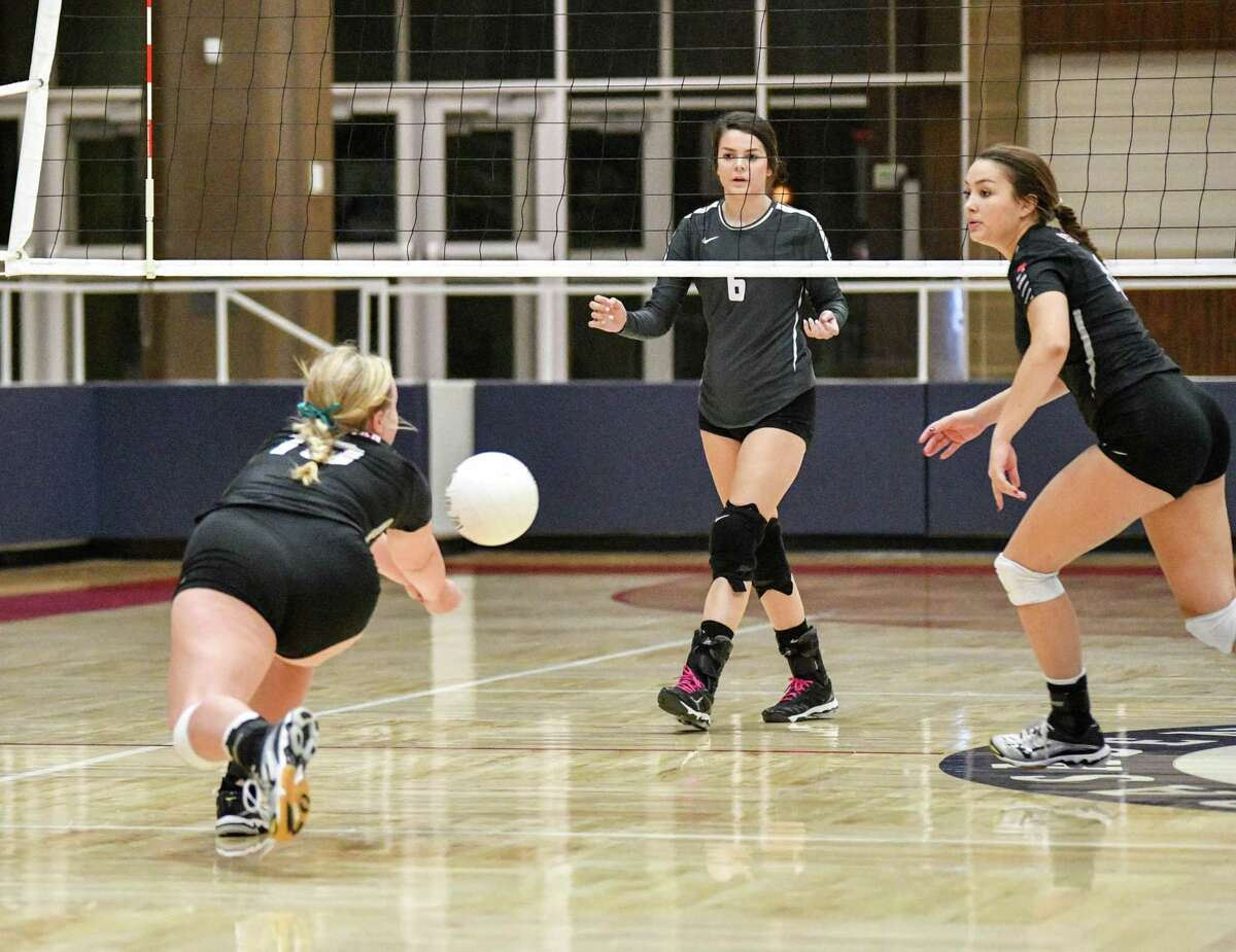 Hargrave's Hagen Pike (10) digs a ball an Area round playoff matchup against Columbia on Nov. 8 at Phillips Fieldhouse in Pasadena