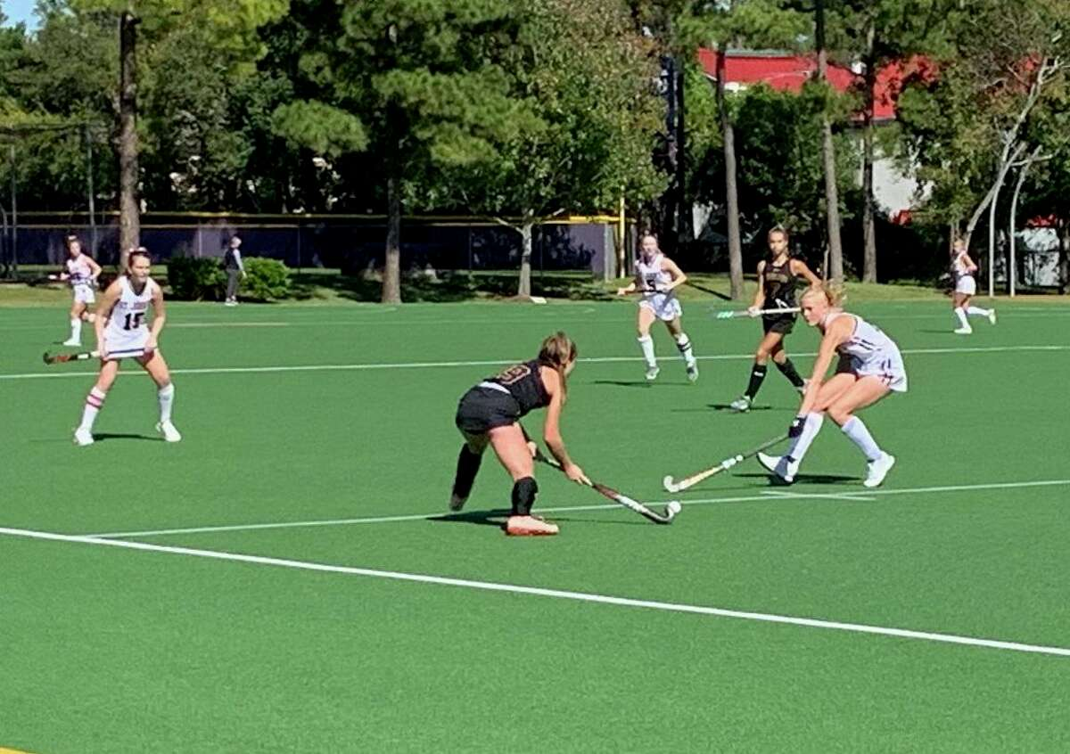Kinkaid's Lauren Moak (19) and Mary VanLoh (17) of St. John's compete for possession during the SPC field hockey championship match Nov. 9 at The Kinkaid School.