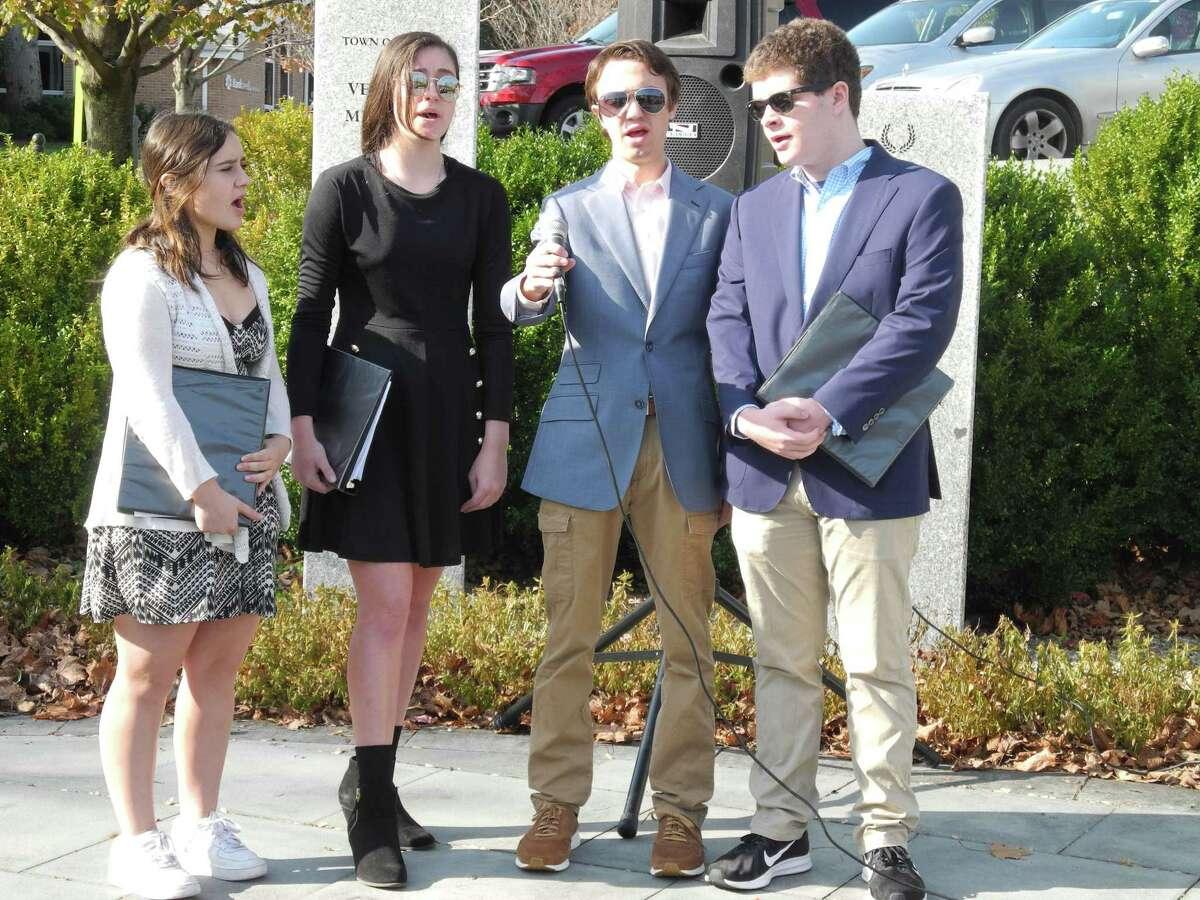 Wilton High School students, from left, Rachel Slater, Anna Clark, Tyler Blain and Ryan Lynn sing the National Anthem.
