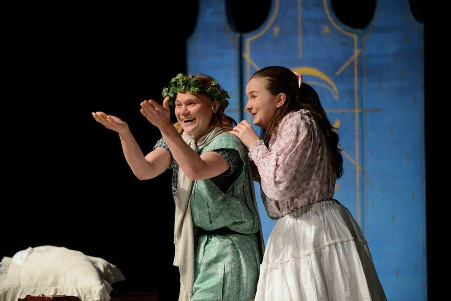 "Peter Pan, played by Hannah Timmons, and Wendy, played by Sara Glancy, perform during a Theatre Works USA performance of ""Peter Pan,"" which is at the Westport Country Playhouse for two performances on December 8 as part of the Playhouse's Family Festivities Series. Photo: Jake Wragge / Norfolk Daily News / Contributed Photo / NORFOLK DAILY NEWS"