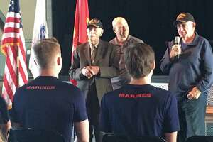 In the caps are World War II veterans Joseph Colwell and L.E. Millholland sharing advice with military recruits at the Nov. 10 Texans Embracing America's Military send-off. Between the veterans is Ralph Oliver, founder of TEAM Send-off Katy.
