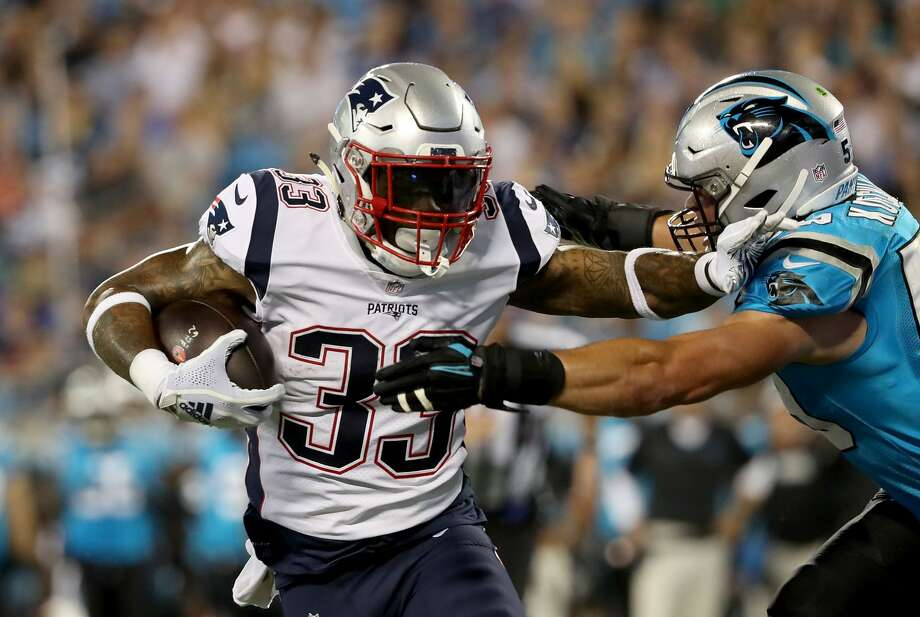 CHARLOTTE, NC - AUGUST 24: Jeremy Hill #33 of the New England Patriots runs the ball against Luke Kuechly #59 of the Carolina Panthers in the second quarter during their game at Bank of America Stadium on August 24, 2018 in Charlotte, North Carolina.  (Photo by Streeter Lecka/Getty Images) Photo: Streeter Lecka/Getty Images
