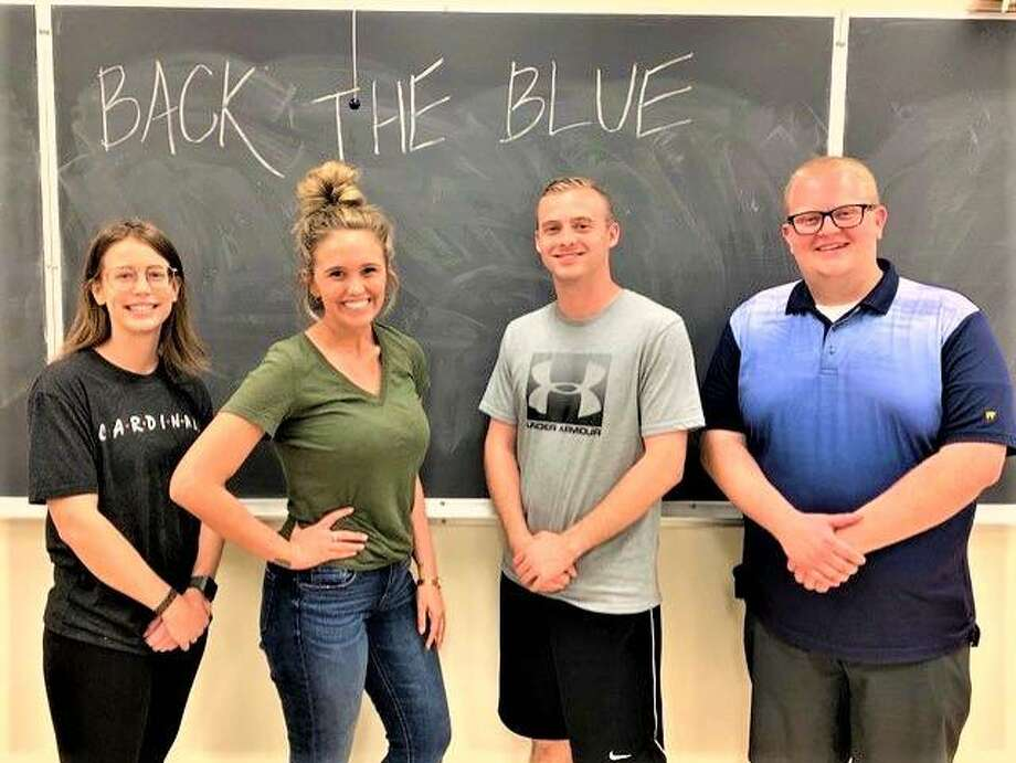 Three Southern Illinois University Edwardsville clubs will host a fundraiser for the family of slain Illinois State Police Trooper Nicholas Hopkins noon to 4 p.m. Saturday, Nov. 16, at American Legion Post 199 in Edwardsville. Organizers, from left, include Alyssa Pratz and Anna Miller of the SIUE Criminal Justice Club, Nathen Peery of the SIUE Chapter of Student Veterans of America and Myles Nelson of the SIUE College Republicans.