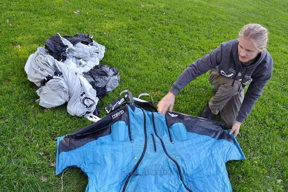 Daniel Ristow unpacks his wingsuit in Bachman Park in Los Gatos. Photo: Gregory Thomas / The Chronicle