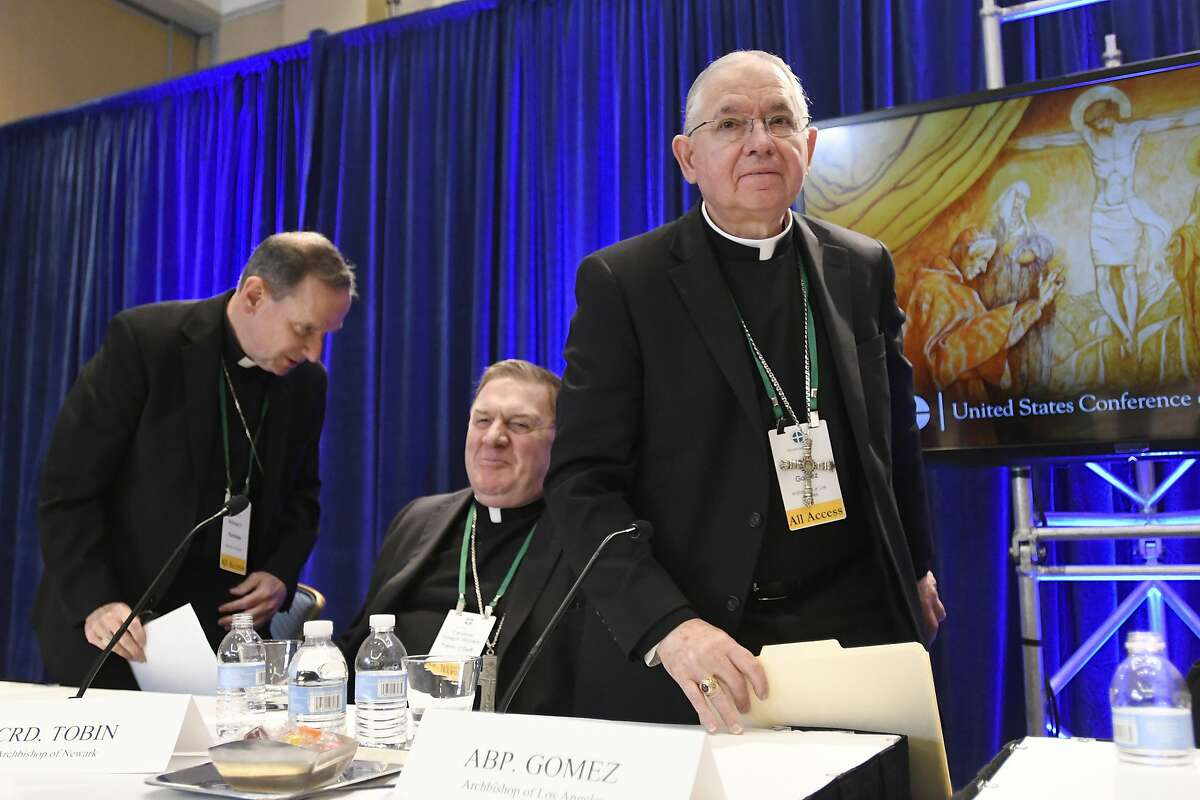 Archbishop Jose H. Gomez, right, of Los Angeles, with Bishop Michael F. Burbidge, left, of Arlington, Va., and Cardinal Joseph William Tobin, of Newark, N.J., exits a news conference after being elected president of the United States Conference of Catholic Bishops during their Fall General Assembly on Tuesday, Nov. 12, 2019 in Baltimore. (AP Photo/Steve Ruark)