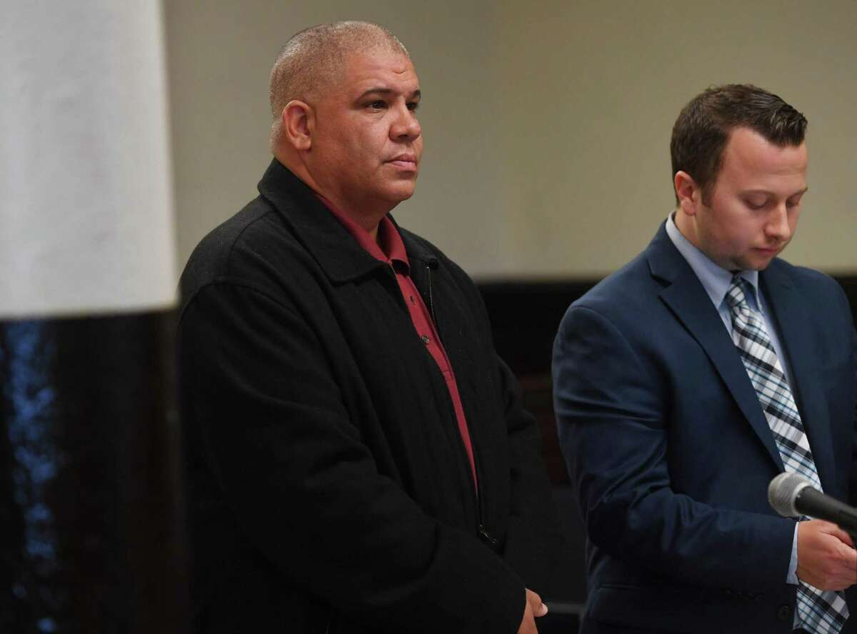 Norwalk Police Officer Hector Delgado, left, 46, of Stratford, appears with his lawyer Noah Kores in Superior Court in Bridgeport, on Tuesday.