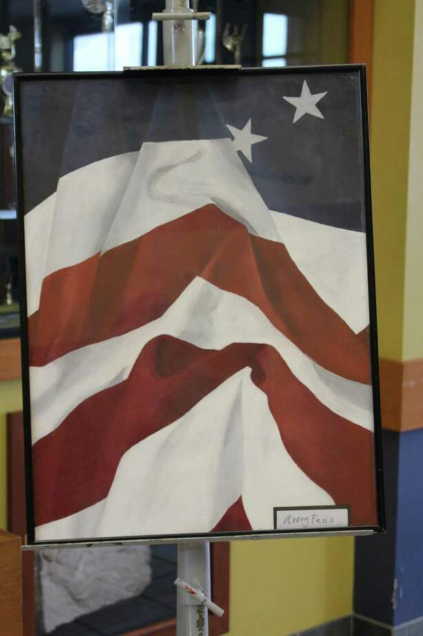 Students in Region 10 honored veterans from their communities Monday with a luncheon, art show and ceremonies. Patriotic artwork filled the Main Lobby at Lewis Mills High School. Photo: Stephanie Cowger / Contributed Photo /
