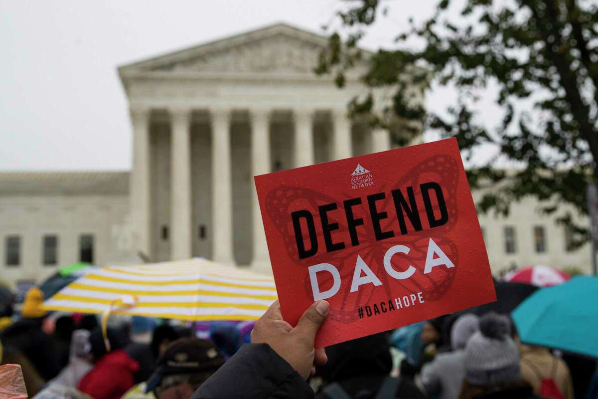 People rally outside the Supreme Court as oral arguments are heard in the case of President Trump's decision to end the Obama-era, Deferred Action for Childhood Arrivals program (DACA), Tuesday at the Supreme Court in Washington.