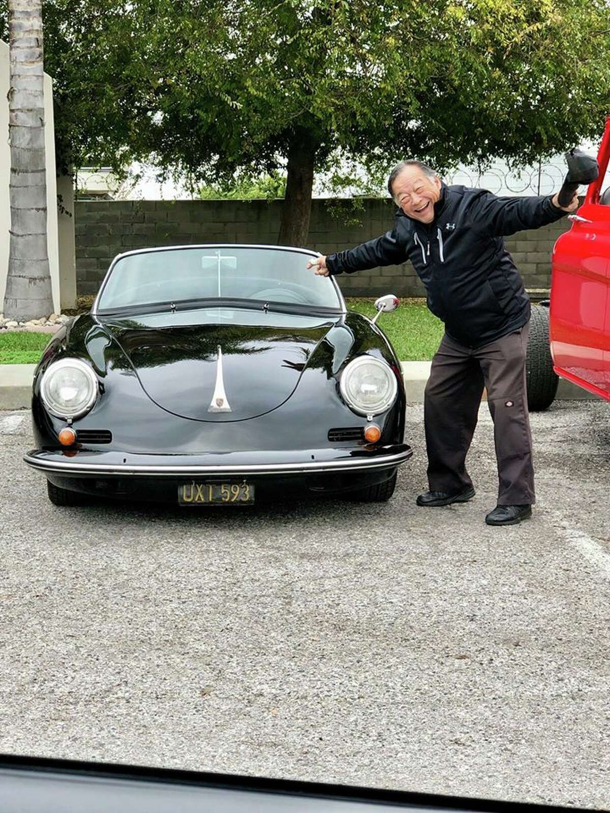 """Chris Nishamura is seen with his 1960 Porsche 356B Roadster, which was stolen Saturday from the Goodguys Rod & Custom Association """"Autumn Get-Together"""" Car Show at the Alameda Fairgrounds in Pleasanton. It had been parked just outside the front gate. (Nov. 12, 2019.)"""