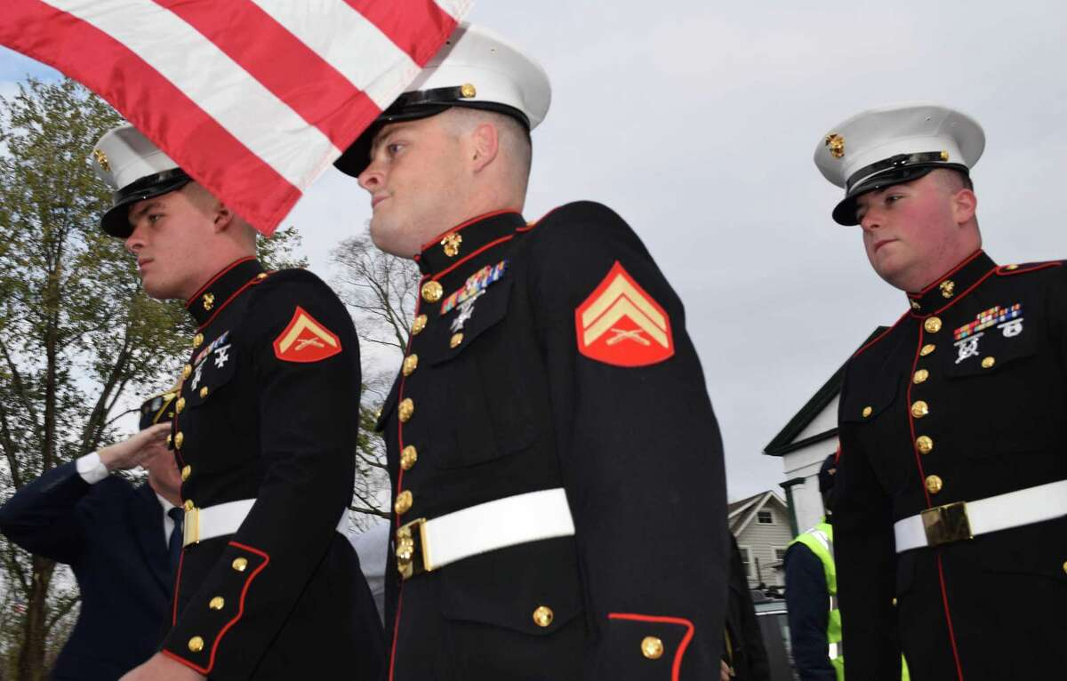 Spectrum/Residents of the town of New Milford gathered Nov. 10, 2019 at the bandstand on the Village Green to welcome home three Marines, Dan Prizio, Dan Capron and Mark Heinonen. Marines, from left to right, Mark Heinonen, Dan Capron and Dan Prizio, are welcomed home through a receiving line of veterans, civic organizations, residents and Scouts.