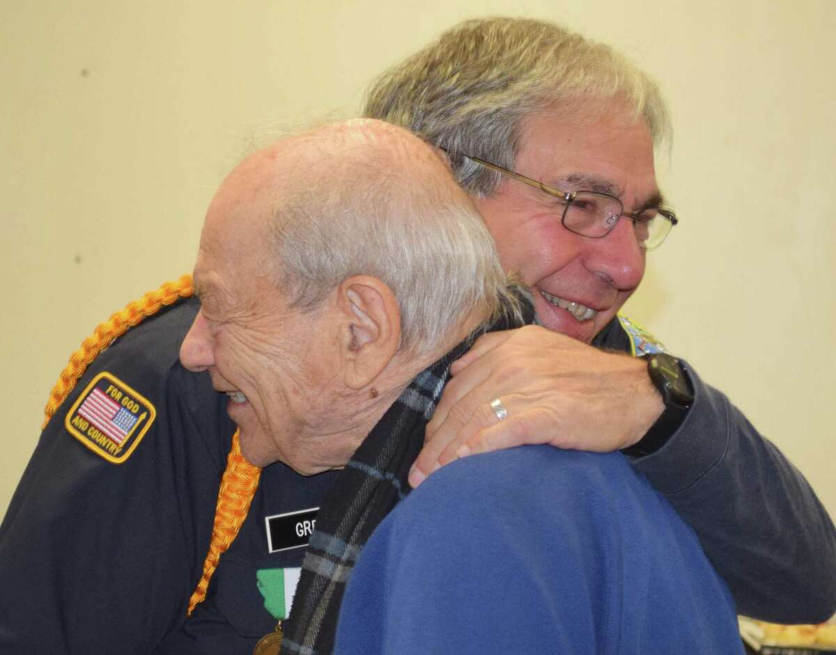 Veterans Joseph Sardone, left, and Bob Greco greet each other during the festivities.