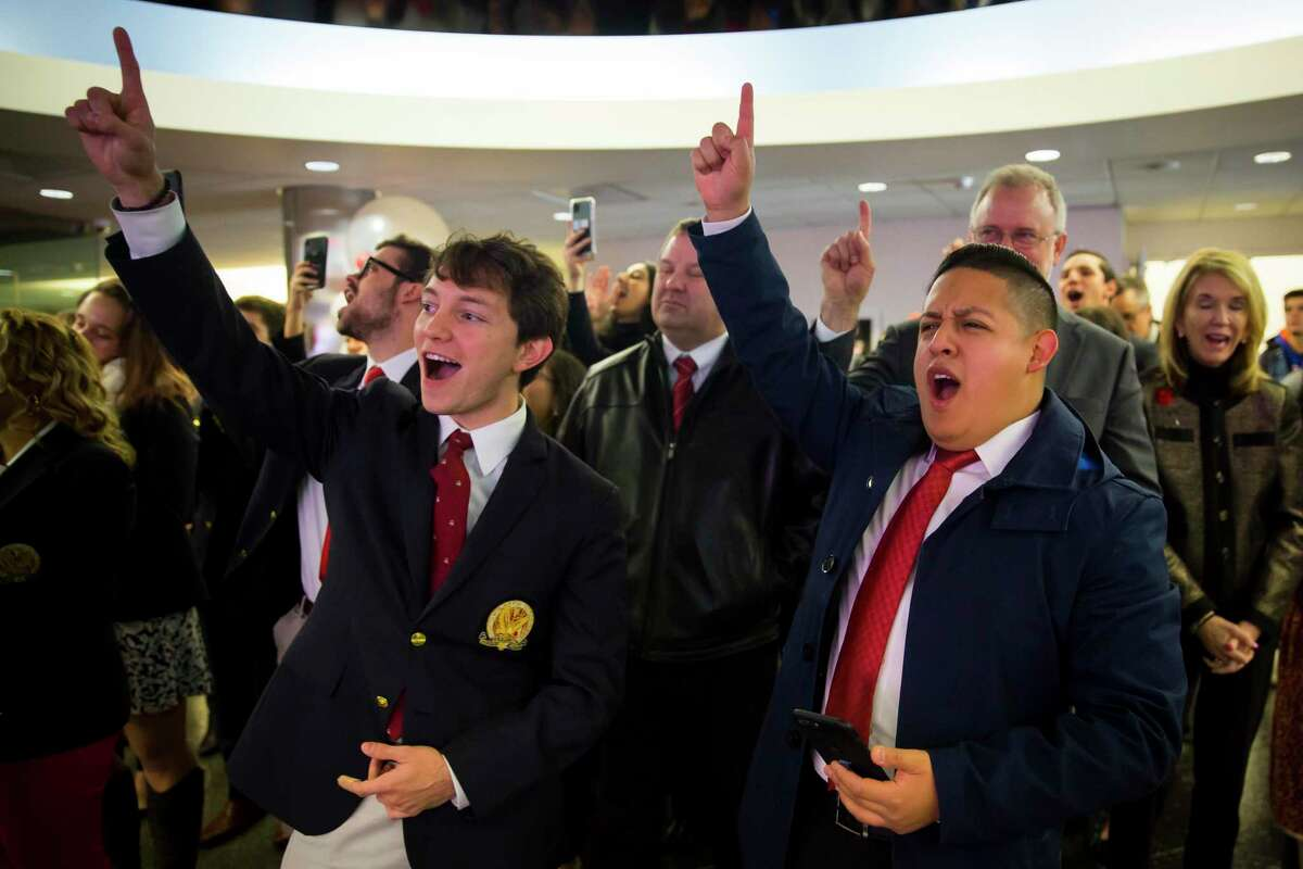 Class of 2020 students Alfred Cervantes and David Jaimes cheer during a celebration on Tuesday, November 12, 2019, at the University of Houston.