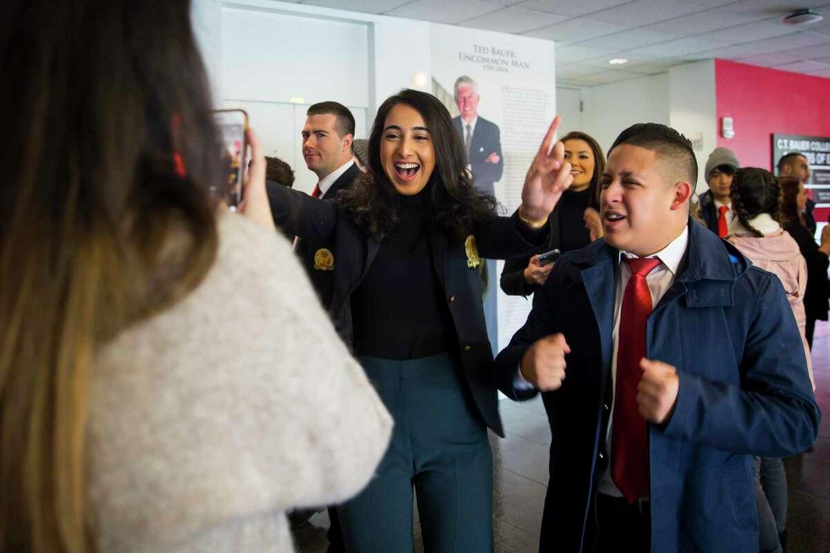 Class of 2020 students Madiha Faisal and David Jaimes during a celebration on Monday, November 12, 2019, at the University of Houston.