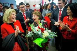 Cyvia Wolff, center, laughs after being presented a bouquet of flowers during a celebration on Tuesday, November 12, 2019, at the University of Houston.