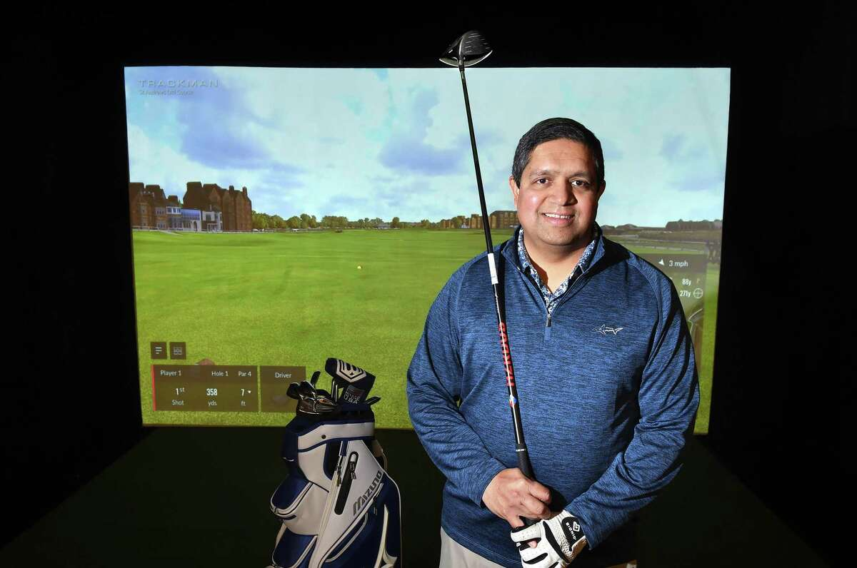 Ajay Gautam, one of three owners of Golf Lounge 18, in front of the virtual St. Andrews Links Old Course in the soon to open virtual reality golfing lounge in Orange.