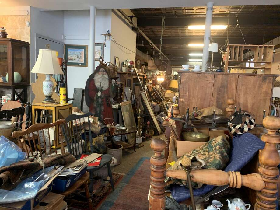 The Antiques Warehouse's owner, Christine Young, has decided to sell the 78 Fourth Street building in Troy after 14 years in business. Photo: Michael Williams / Albany Times Union
