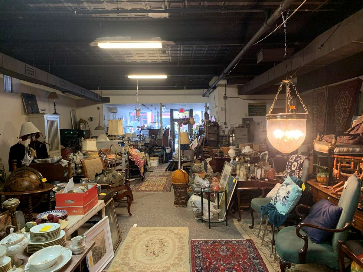 The Antiques Warehouse's owner, Christine Young, has decided to sell the 78 Fourth Street building in Troy after 14 years in business.