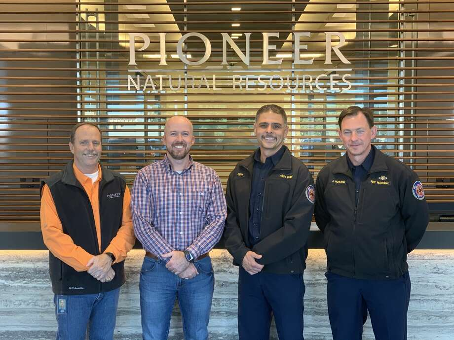 Pioneer Natural Resources recently donated body armor to Midland Fire Marshals. Left to right are, Patrick Repman, PNR Emergency Management; John Buck, PNR Operations; Michael Cota, assistant chief of the Midland Fire Department and Jimmy Howard, fire marshal of the Midland Fire Department. Photo: Courtesy Pioneer Natural Resources