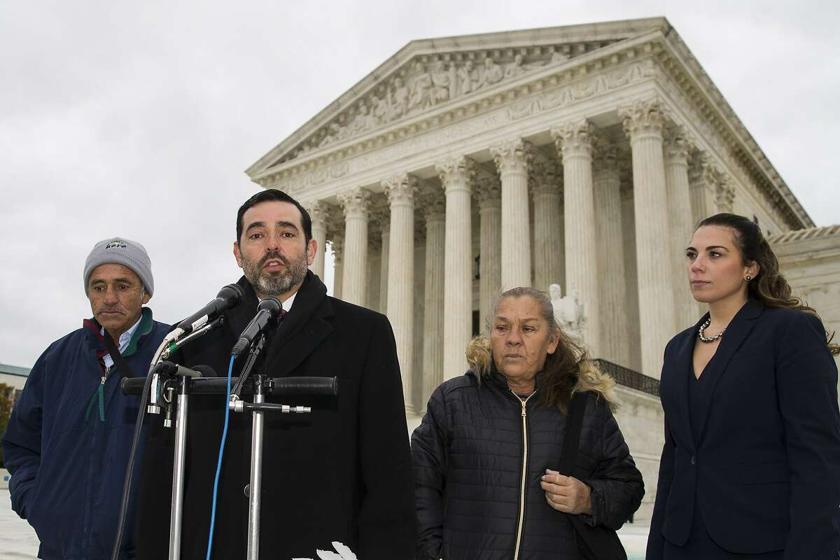 Attorney Cristobal Galindo, second from left, speaks accompanied by Jesus Hernandez, left, and Maria Guereca, and attorney Marion Reilly in front of the Supreme Court, Tuesday, Nov. 12, 2019, in Washington, after oral arguments. The case involves U.S. border patrol agent Jesus Mesa, Jr., who fired at least two shots across the Mexican border, killing Sergio Adrian Hernandez Guereca, 15, who'd been playing in the concrete culvert between El Paso and Cuidad Juarez. (AP Photo/Alex Brandon)