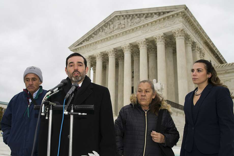 Attorney Cristobal Galindo, second from left, speaks accompanied by Jesus Hernandez, left, and Maria Guereca, and attorney Marion Reilly in front of the Supreme Court, Tuesday, Nov. 12, 2019, in Washington, after oral arguments. The case involves U.S. border patrol agent Jesus Mesa, Jr., who fired at least two shots across the Mexican border, killing Sergio Adrian Hernandez Guereca, 15, who'd been playing in the concrete culvert between El Paso and Cuidad Juarez. (AP Photo/Alex Brandon) Photo: Alex Brandon, Associated Press