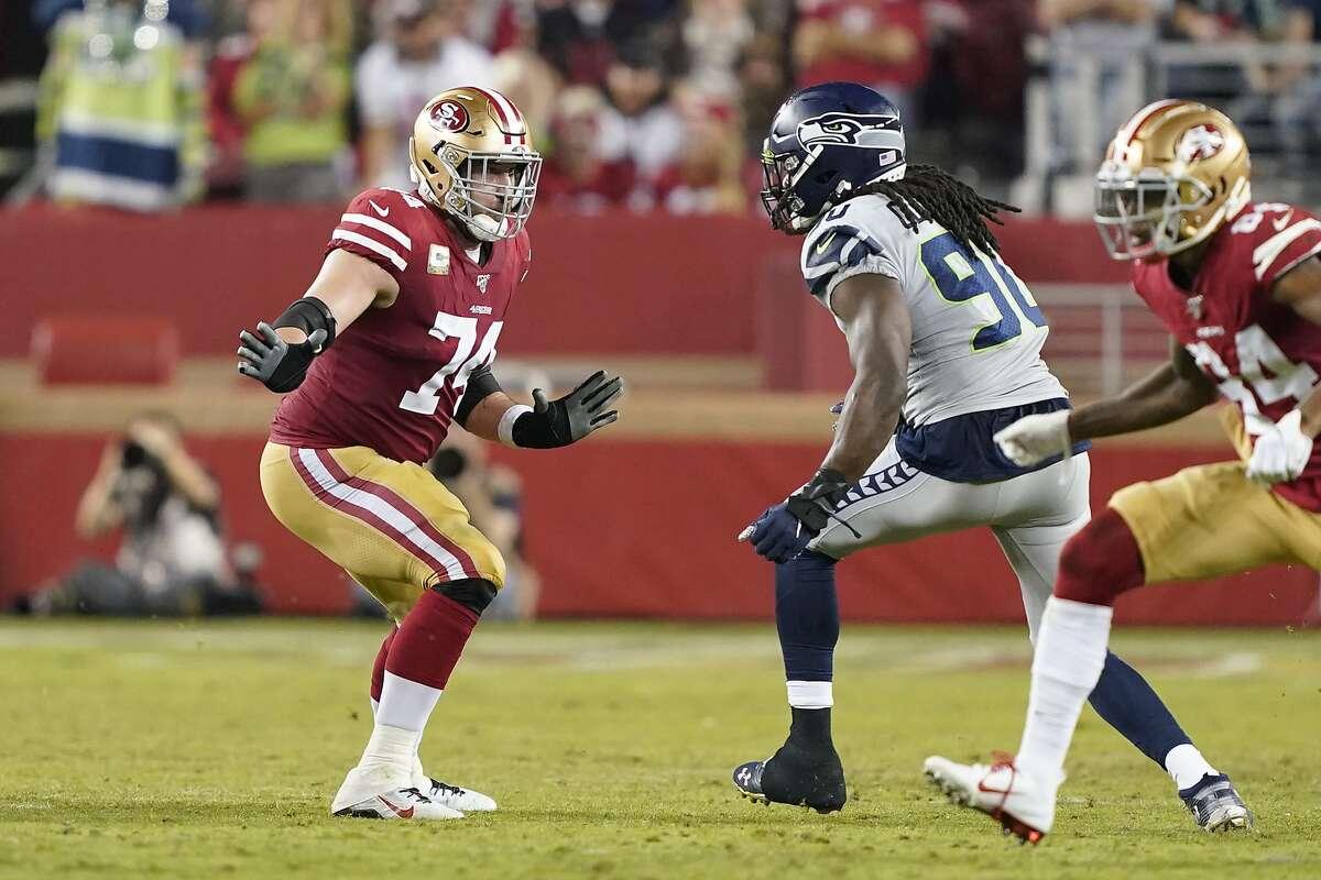 San Francisco 49ers offensive tackle Joe Staley (74) blocks Seattle Seahawks defensive end Jadeveon Clowney (90) during the first half of an NFL football game in Santa Clara, Calif., Monday, Nov. 11, 2019. (AP Photo/Tony Avelar)
