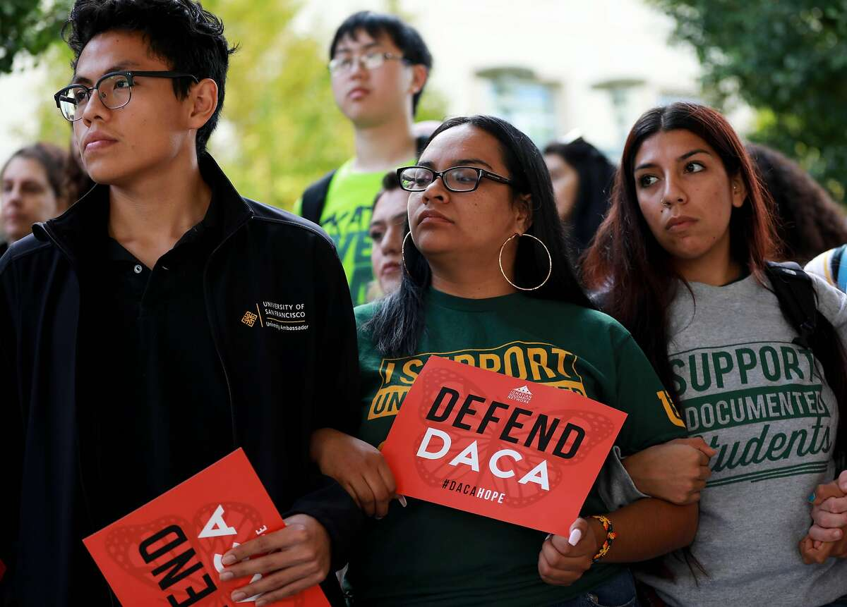 DACA recipients Arnoldo Valdivieso, left, 20, a sophomore, and Dioscelenne Tlatenchi Guzman, 20, right, a junior, attend a vigil and teach-in protest at the University of San Francisco, coinciding with other protests against the Trump administration's attempts to dismantle the DACA program, in San Francisco, Calif., on Tuesday, November 12, 2019. The woman in the middle didn't want to provide her name. On Tuesday, the Supreme Court heard oral arguments regarding whether or not former President Barack Obama overstepped his legal authority when he created the DACA program during his tenure. The Trump administration maintains the program has introduced thousands of people into American society who have become criminals, while proponents point to the many thousands who have grown up to become high-achieving, productive members of their communities.