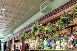 "Above, dozens of nutcracker dolls fill the shelves of the Nutmeg Dance Shop, a popular item as Nutmeg Ballet's annual production of ""The Nutcracker"" is weeks away."
