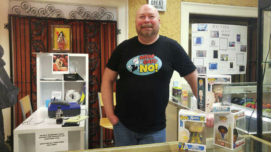 "Fred Pollard, co-owner of ""Mom Said No"" inside the Mineral Springs Mall on East Broadway in Alton, specializes in new and classic gifts and toys, used comic books and vintage collectibles. Photo: Jeanie Stephens