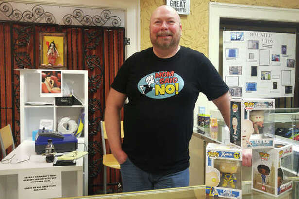 "Fred Pollard, co-owner of ""Mom Said No"" inside the Mineral Springs Mall on East Broadway in Alton, specializes in new and classic gifts and toys, used comic books and vintage collectibles."