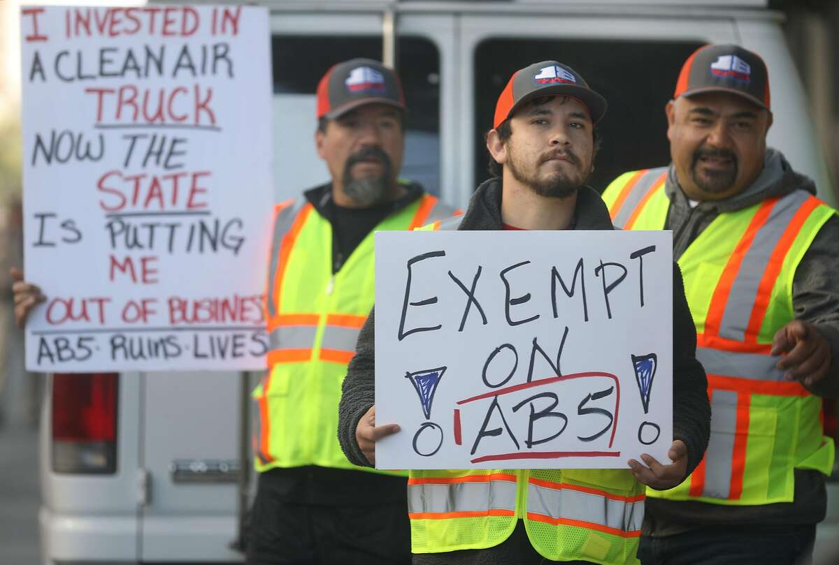 Independent owner-operator truck drivers protest AB5 in front of 455 Golden Gate Ave. on Wednesday, Nov. 6, 2019, in San Francisco, Calif.