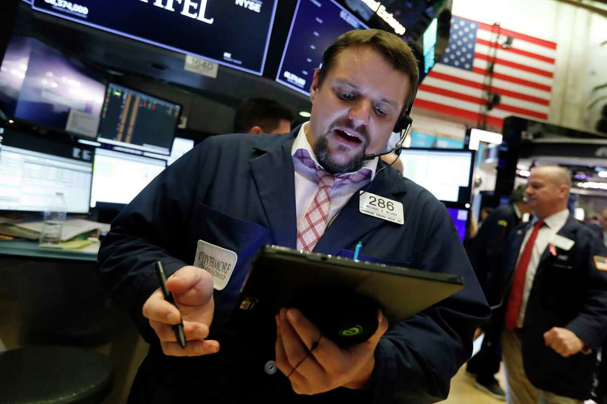 Trader Michael Milano works on the floor of the New York Stock Exchange, Tuesday, Nov. 12, 2019. Stocks are opening slightly higher on Wall Street, led by gains in technology and health care companies. (AP Photo/Richard Drew)