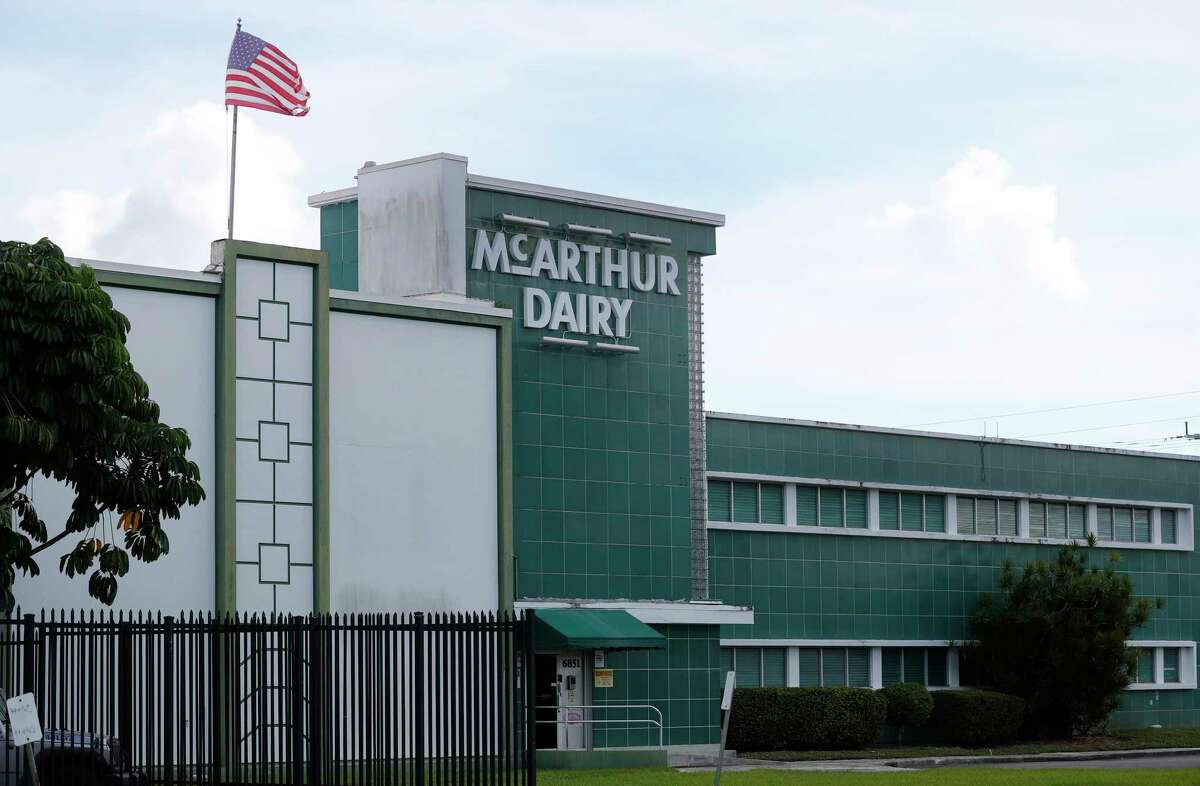 A McArthur Dairy building, a Dean Foods brand, is shown, Tuesday, Nov. 12, 2019, in Miami. Dean Foods, America's biggest milk processor, filed for bankruptcy Tuesday amid a steep, decades-long drop-off in U.S. milk consumption blamed on soda, juices and, more recently, nondairy substitutes. (AP Photo/Wilfredo Lee)