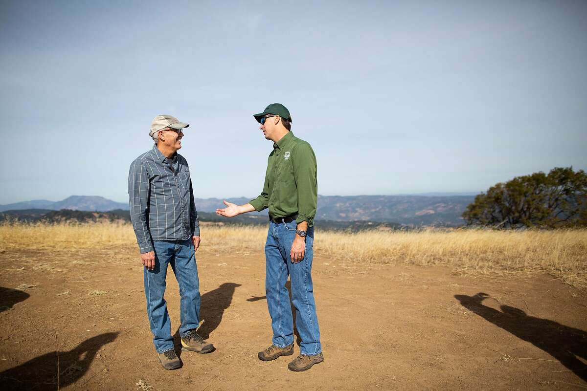 Jim Perry (left), who is selling his historic 654-acre McCormick Ranch talking with Bert Whitaker (manager of the Sonoma County Regional Parks to the Sonoma Land Trust on McCormick Ranch, Sonoma County, California, November 12th, 2019. Sonoma Land Trust has signed an agreement to purchase the historic 654-acre McCormick Ranch, which spans the ridge between Sonoma and Napa Counties in the southern Mayacamas Mountains, for $14.5 million. The purchase is scheduled to close in November 2020 and ownership will be transferred to local park agencies.