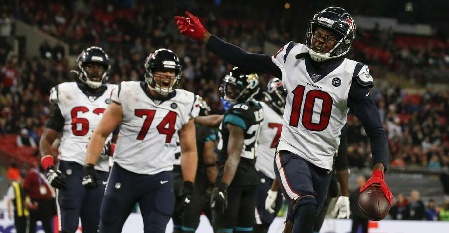 PHOTOS: Texans vs. Jaguars Houston Texans wide receiver DeAndre Hopkins (10) celebrates his 1-yard touchdown reception against the Jacksonville Jaguars during the fourth quarter of an NFL football game at Wembley Stadium on Sunday, Nov. 3, 2019, in London. Browse through the photos to see action from the Texans' win over the Jaguars in London. Photo: Brett Coomer/Staff Photographer